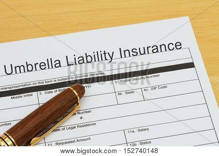 Applying for a Umbrella Liability Insurance Umbrella Liability Insurance application form with a pen on a desk