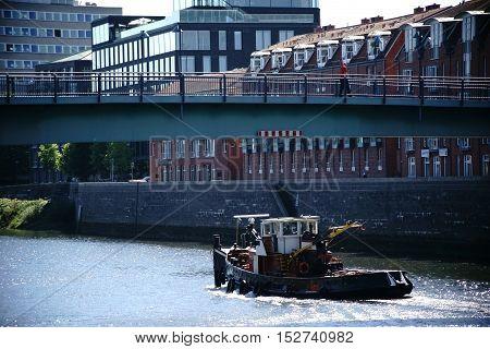 A pedestrian bridge over the Weser overlooking the buildings of the University of Bremen.