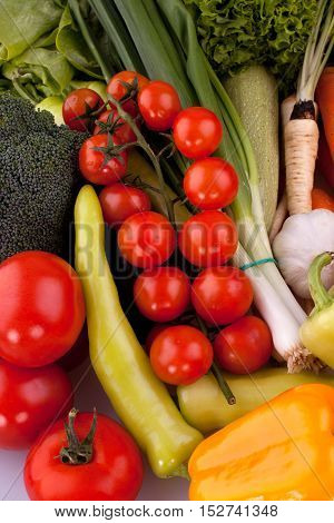 Cherry tomatoes with other fresh vegetables, background.