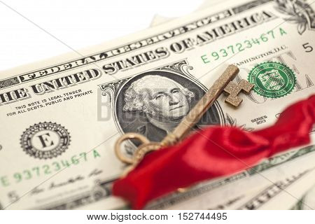 Key to success on dollar banknotes isolated