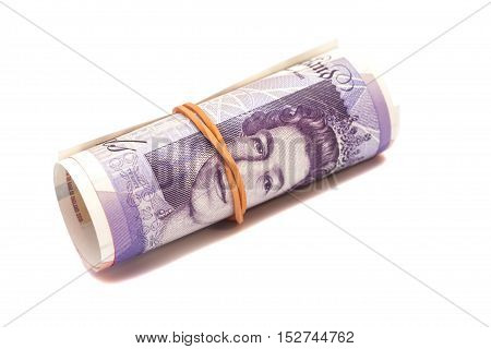 money british pounds sterling gbp under rubber band isolated