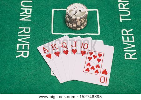 Poker cards royal flush and casino chips