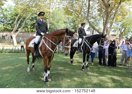 ISTANBUL TURKEY - JULY 30 2016: Cavalry soldiers in Topkapi Palace Garden. Topkapi Palace was one of the major residences of the Ottoman sultans for almost 400 years