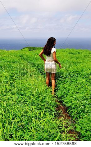 Teenage Girl Walks Through Bushes