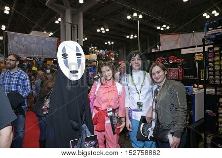 NEW YORK NEW YORK - OCTOBER 9: People wearing costumes from anime movie Spirited Away at NY Comic Con at Jacob K. Javits convention center. Taken October 9 2016 in New York.