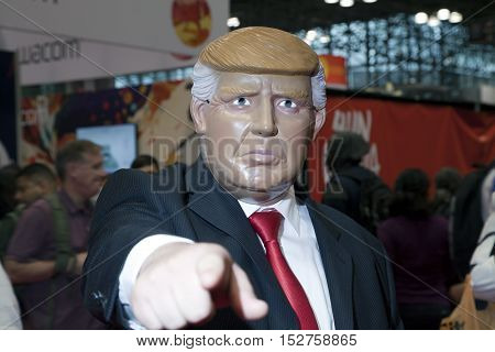 NEW YORK NEW YORK - OCTOBER 9: Man wearing Donald Trump costume at NY Comic Con at Jacob K. Javits convention center. Taken October 9 2016 in New York.