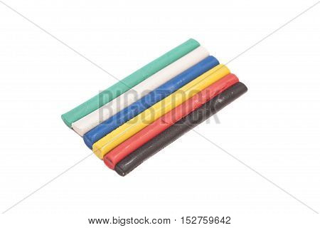 Colorful plasticine on a white background .
