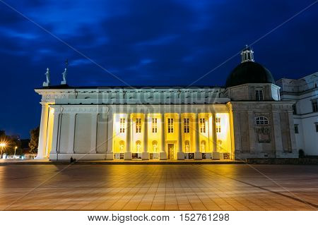 Vilnius, Lithuania. Night Or Evening View Of Cathedral Basilica Of St. Stanislaus And St. Vladislav At The Cathedral Square. Blue Cloudy Sky Background. Travel In Lithuania. Copyspace