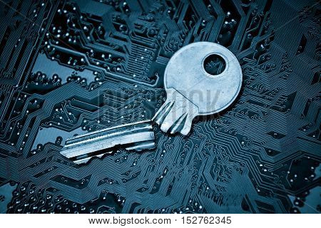 A broken key on computer circuitboard background / computer security breach concept