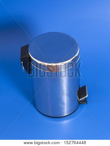 Garbage bin  pedal silver on blue background