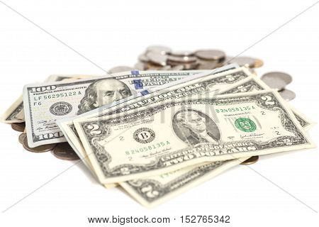 US dollars banknote and coins on white background