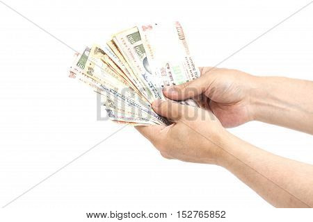 Hand with Indian rupee notes isolated on white