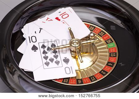 Roulette Wheel And Playing Card. Gambling Concept