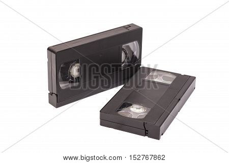 Old vhs video cassettes isolated on white