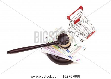 Hammer of judge pushcart and euro money isolated on white background