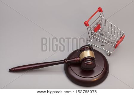 Justice Gavel with Shopping Cart on gray background