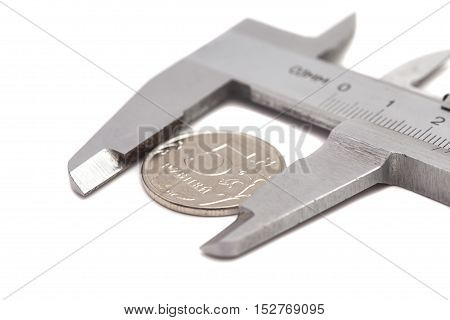 Vernier calipers with coin isolated on white