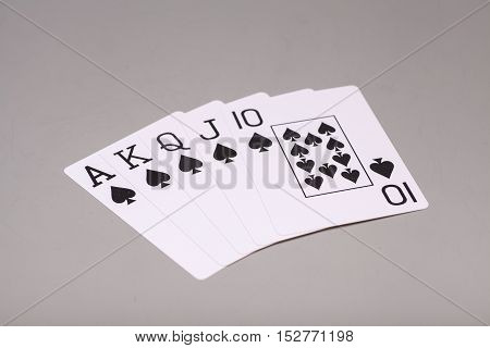 Royal Flush (playing cards) on gray background