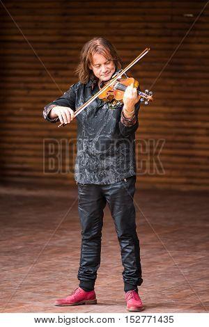 Silver Spring, USA - September 17, 2016: Vasyl Popadiuk virtuoso playing violin during Ukrainian festival performance
