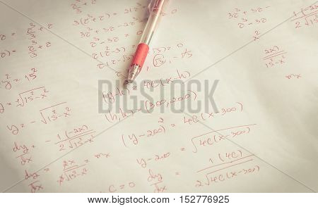 red pen on advanced mathematics (maths) in vintage style