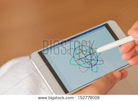 Student doing online tutorials about geometry. on mobile phone