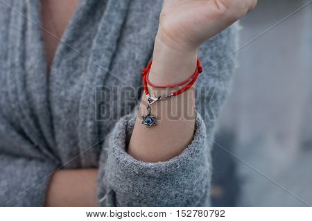 Necklace with the Star of David on a girl's hand