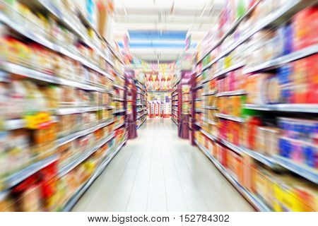 Supermarket shelves on both sides of the aisle.