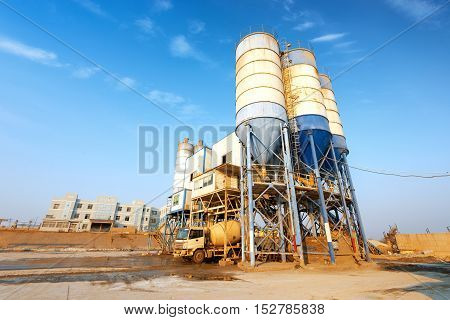 Concrete mixing tower. Concept of on-site construction facility.