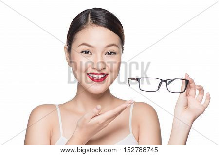 Proposing product. Beauty asian girl showing glasses