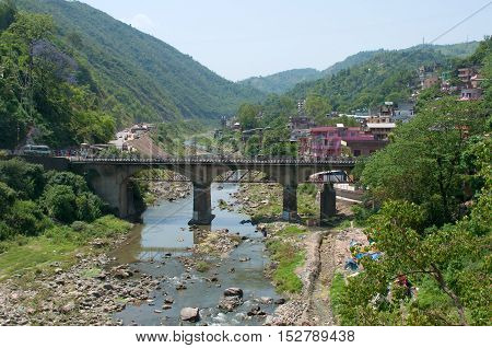 MANDI, INDIA - MAY 12, 2011: Road bridge over the river in the city of Saket Mandi. Himachal Pradesh, Road bridge over the river in the city of Saket Mandi. Himachal Pradesh, India. Tourist landmark