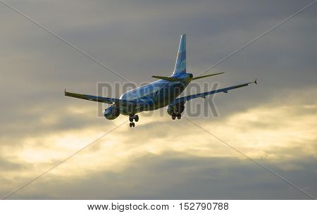 SAINT PETERSBURG, RUSSIA - JULY 24, 2015: Flying on the sunset sky background Airbus A319-111 (VQ-BAS) of the airline