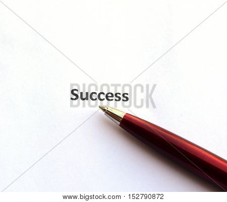 success with pen isolated on white background.