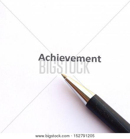Achievement with pen isolated on white background.