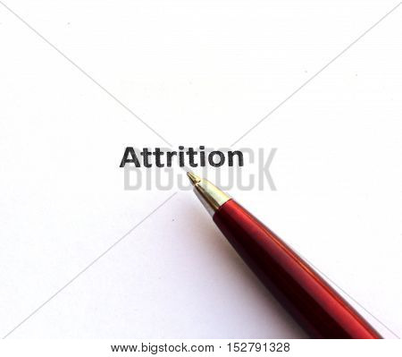 Attrition with pen isolated on white background.