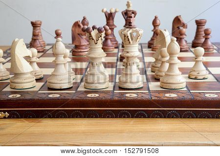 A closeup of chess pieces on chessboard