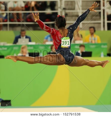 RIO DE JANEIRO, BRAZIL - AUGUST 7, 2016: Olympic champion Simone Biles of United States competes on the floor exercise during women's all-around gymnastics qualification at Rio 2016 Olympic Games