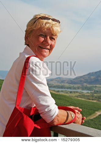 Smiling lady on a balcony.