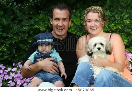 Young family, mom, dad, baby and dog.