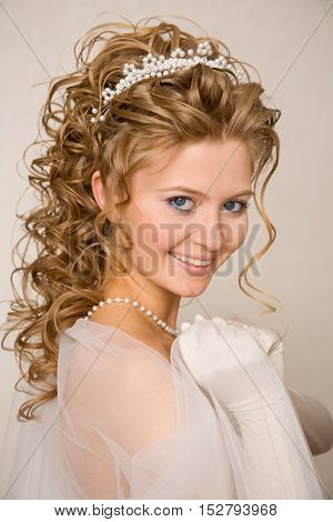 Young smiling bride with diadem on her head
