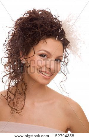 Cheerful bride with feather hairpin in her hair isolated on the white background
