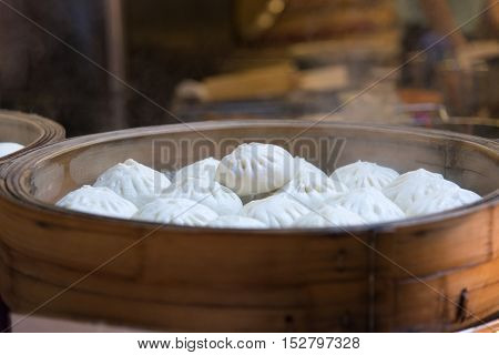 Traditional Chinese steamed buns in bamboo steamer