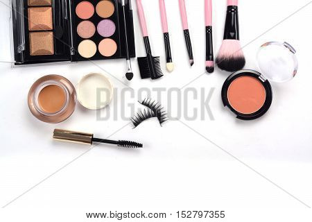makeup brush and cosmetics isolated on white background.