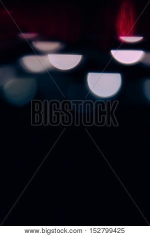 Abstract background with white glowing semicircles and red on a black background.