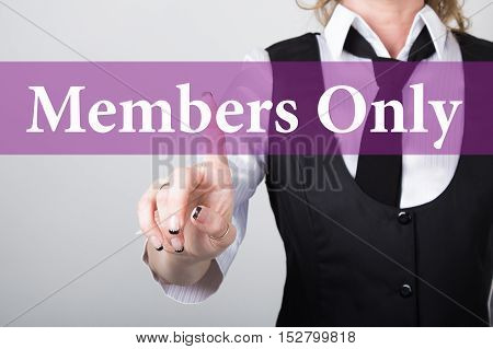 members only written on virtual screen. technology, internet and networking concept. woman in a black business shirt presses button on virtual screens.