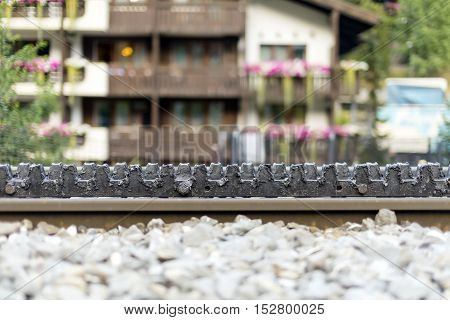 toothed rack rail of the rack railway, also called rack-and-pinion railway in Zermatt, Switzerland. The trains are fitted with one or more cog wheels or pinions that mesh with this rack rail.