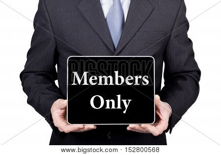 members only written on virtual screen. technology, internet and networking concept. man in a business suit and tie holds a PC tablet.