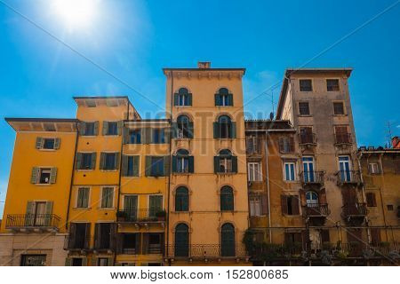 VERONA ITALY- September 08 2016: View on the old high houses of local citizens located on Piazza delle Erbe (Market square) in Verona Italy.