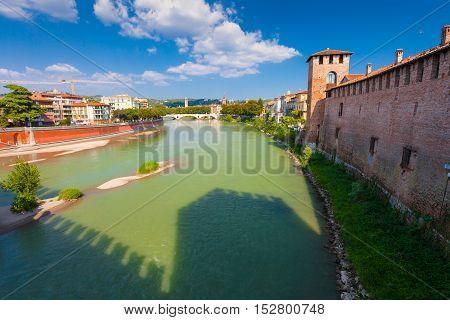 VERONA ITALY- September 08 2016: Scenery with Adige River and Ponte della Vittoria from Castelvecchio Bridge (Ponte di Castelvecchio) in summer day.