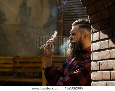 Hipster With Cigarette And Razor