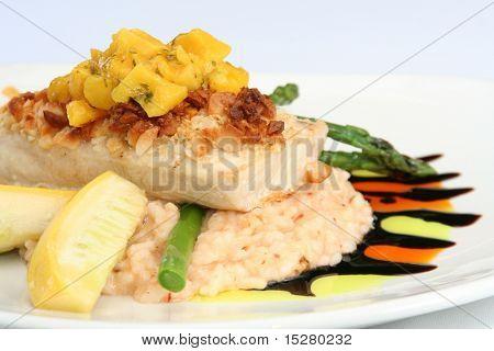 Gourmet meal, macadamia crusted mahi mahi with mango salsa on risotto. poster